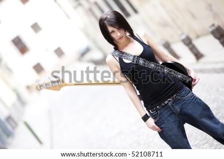 Young beautiful street artist staring at camera.
