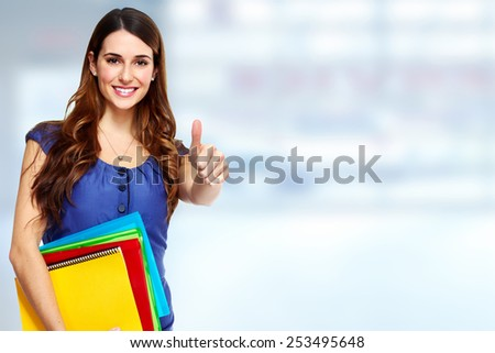 Shutterstock Young beautiful student woman portrait. Education background.