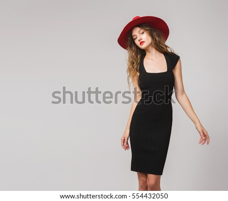 young beautiful stylish woman in black dress, red hat, red lipstick, sexy, elegant,  #554432050