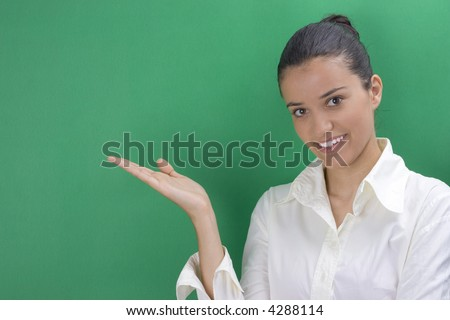 young beautiful teacher in white on green background