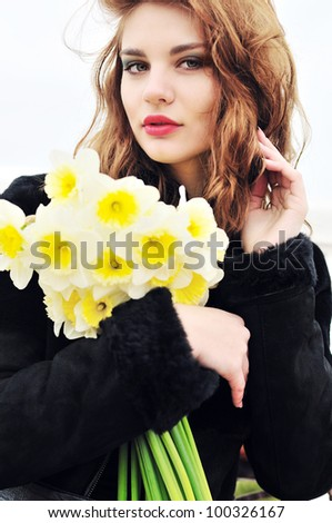 young beautiful teen girl with daffodils