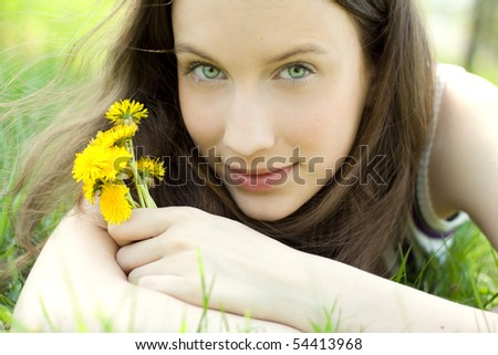 young beautiful teenager with dandelion bouquet #54413968