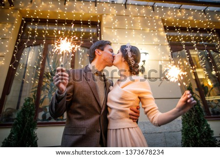 young beautiful wedding couple holding bengal lights #1373678234