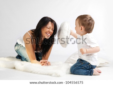 Young beautiful woman and her son having fun together