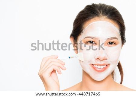 Young beautiful woman applying yogurt facial mask Skin care, beauty treatments on white background #448717465