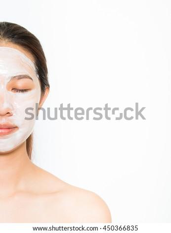 Young beautiful woman applying yogurt facial mask Skin care, beauty treatments on white background #450366835