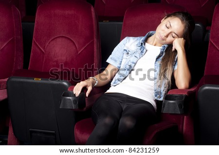young beautiful woman asleep in the cinema