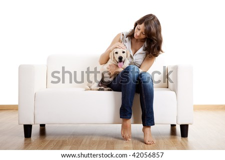 Young beautiful woman at home with her cute dog