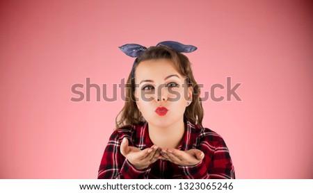 Young beautiful woman blowing a kiss #1323065246