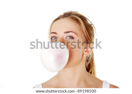 Young beautiful woman blowing bubble gum