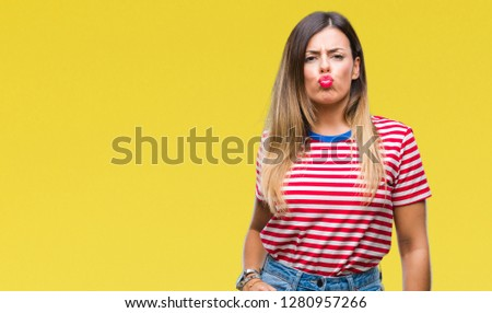 Young beautiful woman casual look over isolated background puffing cheeks with funny face. Mouth inflated with air, crazy expression. #1280957266