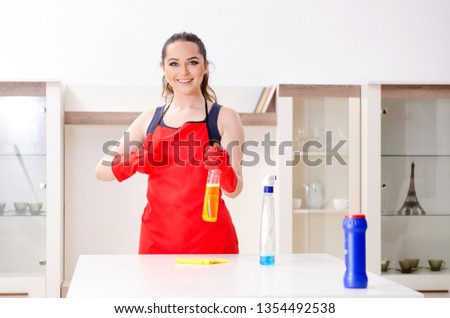 Young beautiful woman cleaning apartment  #1354492538