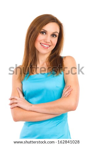 Young beautiful woman consultant smiling at camera. Young woman standing with crossed arms and smiling at camera. Three quarter length studio shot isolated on white.