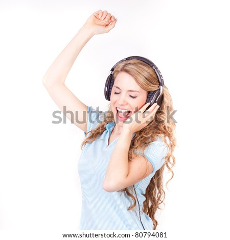young beautiful woman dancing and listening music on with headphones isolated on white background