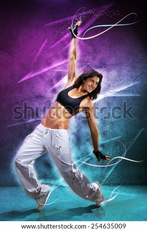 Young beautiful  woman dancing modern dance hip-hop on colorful  background. With lights effect.