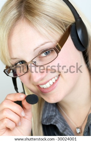 Young beautiful woman discuss with customer via headset
