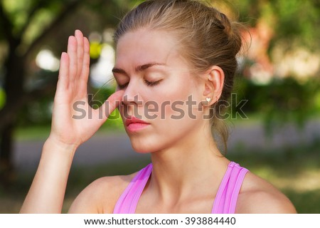 young beautiful woman doing breathing exercise,  #393884440