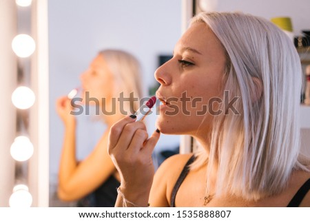 Young beautiful woman doing her make up. Beauty concept. Indoors. Fashion model lifestyle. Fashion model lifestyle. Young beautiful woman doing her make up. Beauty concept. Indoors. #1535888807