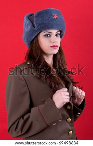http://image.shutterstock.com/display_pic_with_logo/2300/2300,1295708602,1/stock-photo-young-beautiful-woman-dressed-as-russian-military-69498634.jpg