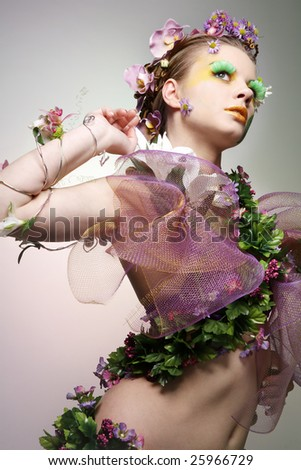 Young beautiful woman dressed as Spring.