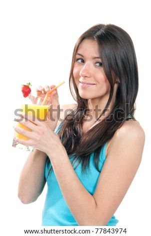 Young beautiful woman drinking fresh orange juice cocktail with strawberry isolated on a white background