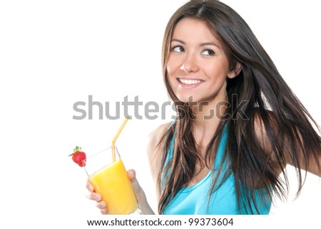 Young beautiful woman drinking orange juice cocktail with strawberry isolated on a white background