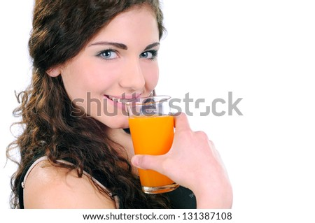 Young beautiful woman drinking orange juice isolated on a white background