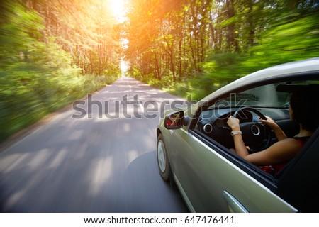 young beautiful woman driving...