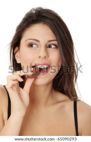 Young beautiful woman eating bar, isolated on white