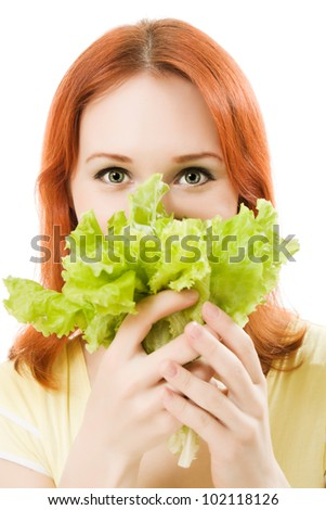 young beautiful  woman eating salad close up - stock photo