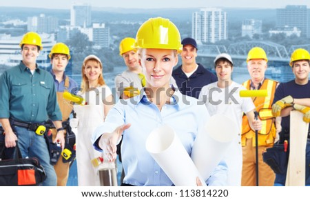 Young beautiful woman engineer and a group of Industrial worker. - stock photo