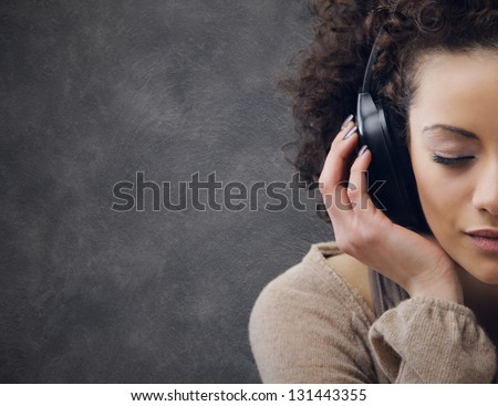 young beautiful woman enjoying music