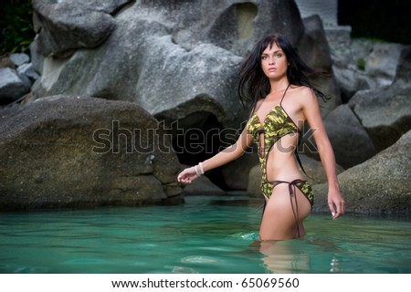 Young beautiful woman enjoying the holidays in tropical lagoon