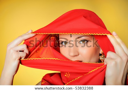 stock photo : Young beautiful woman eyes in indian traditional jewelery,