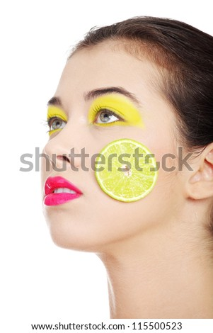 Young beautiful woman face with yellow eye make up, isolated on white