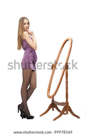 young beautiful woman get dressing near mirror
