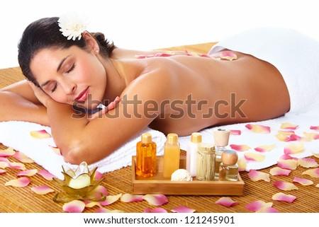 Young beautiful woman getting massage in spa salon.