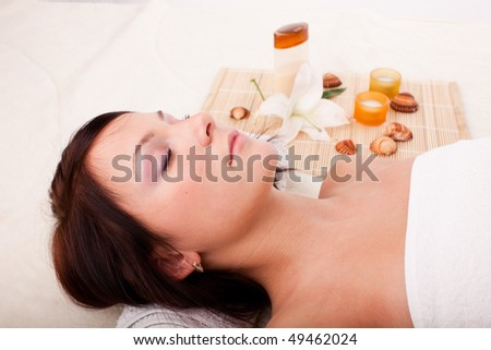 Young beautiful woman getting spa treatment  on a  white background