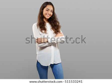 Young beautiful woman girl model posing on gray background looking camera #511533241