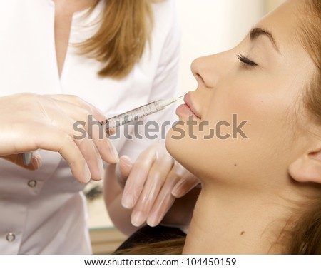 young beautiful woman having an injection mesotherapy