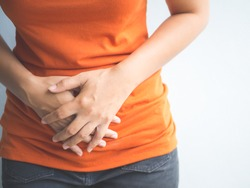 Young beautiful woman having painful stomachache.Chronic gastritis. Abdomen bloating concept.