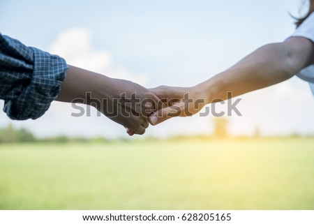 Young beautiful woman Hold hands with lovers