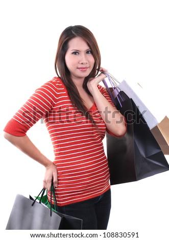 young beautiful woman holding a few shopping bags - stock photo