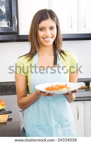 young beautiful woman holding a plate of cooked food