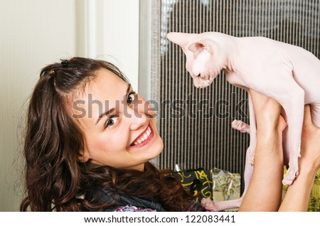 young beautiful woman   holds a cat