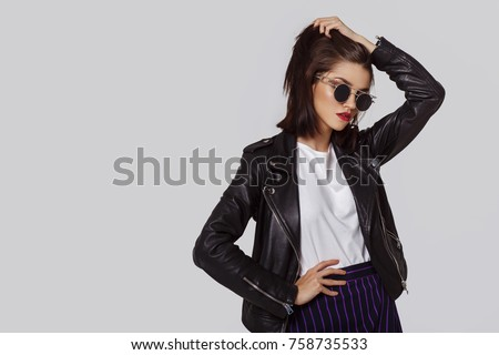 Young beautiful woman in a black jacket.