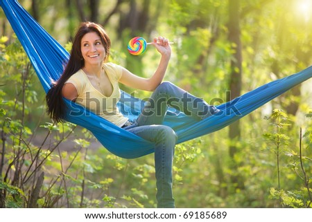 young beautiful woman in a hammock