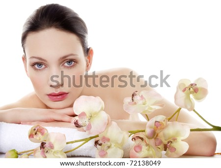 Young beautiful woman in a spa. Space for text.