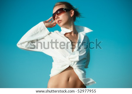 Young Beautiful Woman In A White shirt