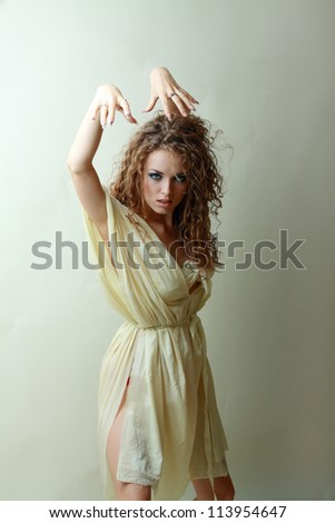 Young beautiful woman in crazy zombie look scaring everybody